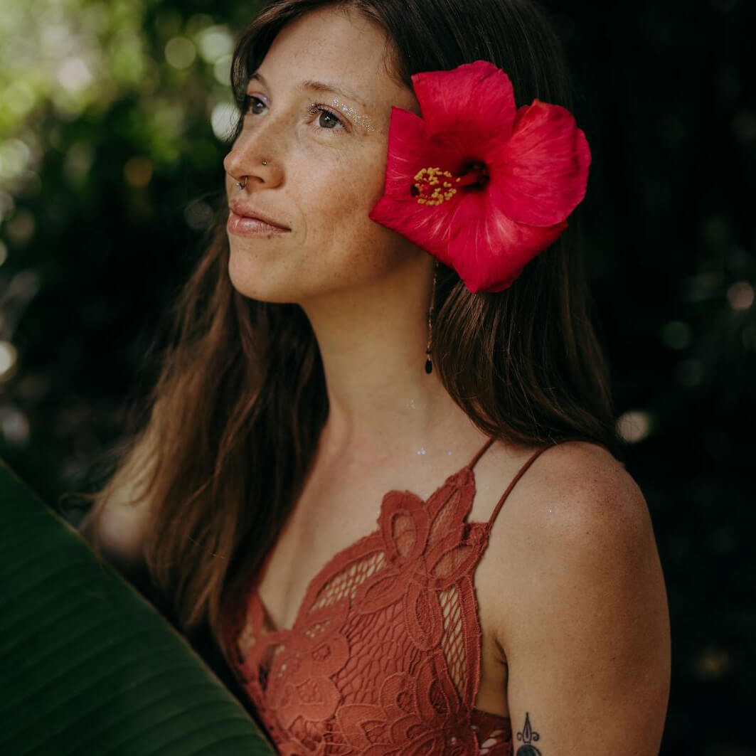 Woman with big red flower in her hair