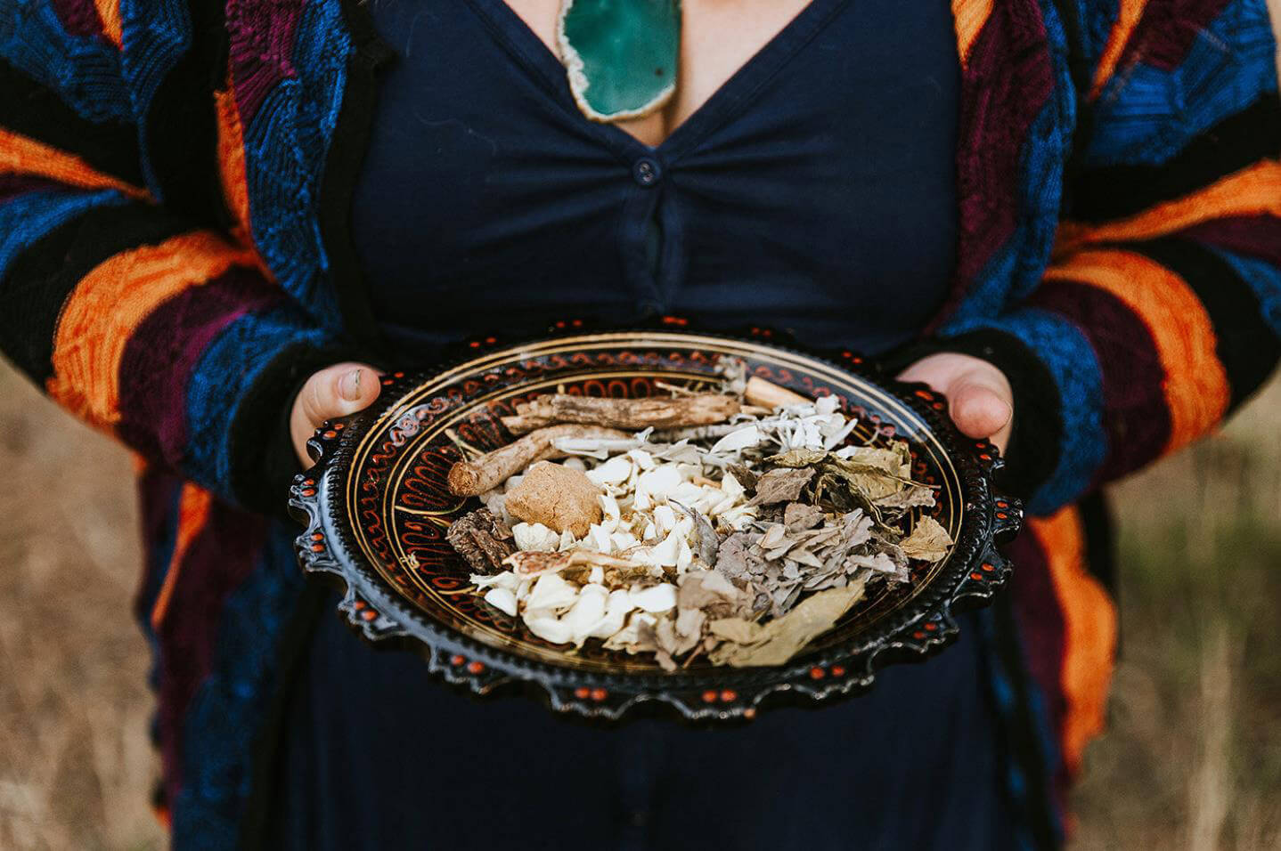 Woman holding a bowl of herbs and rustic
