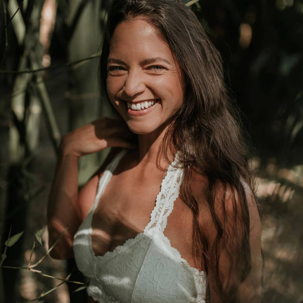 Woman smiling in white